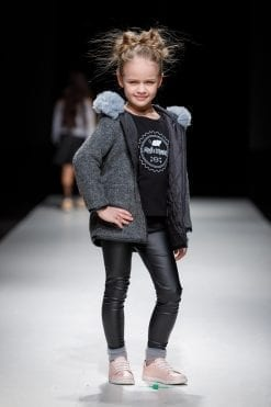 Wool blend winter coat with blue tulle ruffle detail, black unisex kids T-shirt with Rock and Mouse logo and leather look leggings with grey tulle socks