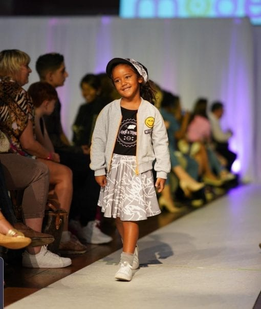 Unisex light grey jacket with yellow detail for kids, boys and girls, black T-shirt with Rock and Mouse logo, first art print skirt and grey tulle socks