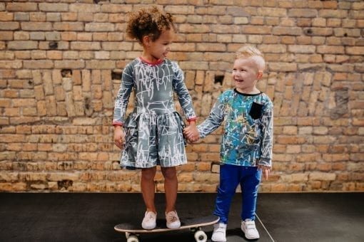 Creative, colourful toddler kids outfits for girl and boy with first art and blue expressions prints and blue pants with wooden buttons