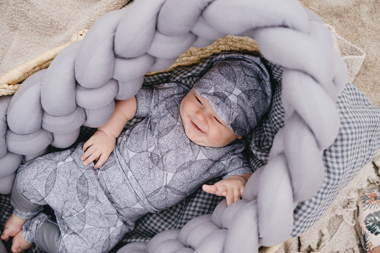 Monochrome unisex baby outfit with dark leaf print for girl or boy