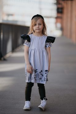 Monochrome flower dress with leather look wings for girls