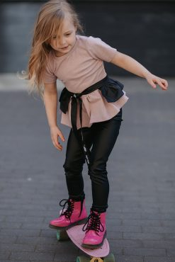 Edgy toddler girls kids outfit with pink, sparkly peplum top, black leather-look leggings and black ruffle belt