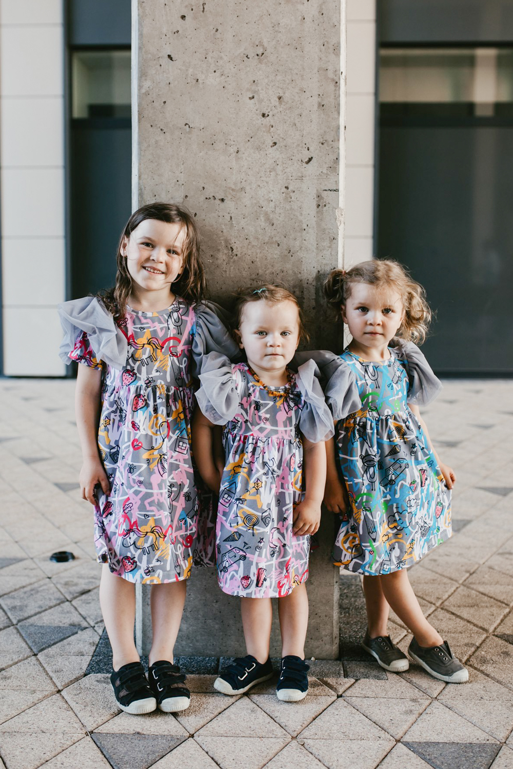 Toddler, baby, kids, girl dresses with first art and pink and blue expressions prints and tulle wings